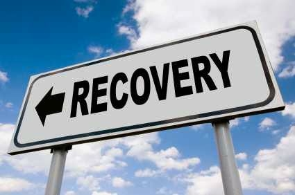 Economic recovery road sign